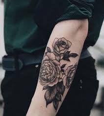 Resultado de imagen para tatuajes de rosas para hombres en el antebrazo