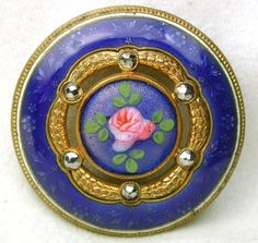 A beautiful French enamel button with faceted steels and a Basse Taille border.  On ebay, it had 13 bids and sold for $46.