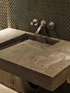 A sleek stone sink combines strength and beauty while the textured metallic backsplash reflects light and adds interest. Industrial Bathroom, Industrial House, Industrial Style, Industrial Metal, Bathroom Wall Colors, Bathroom Ideas, Bathroom Photos, Masculine Bathroom, Concrete Sink