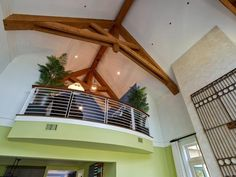 Looking Upstairs: The loft railing system, capped with sustainable mahogany, hovers balcony-like over the great room.  http://www.hgtv.com/dream-home/hgtv-dream-home-2013-loft-pictures/pictures/page-2.html?soc=dhpp