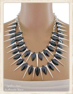 """The Tabatha Necklace - Black - with a new attitude!  Looking to stand out from the crowd? Look no further than this bold statement necklace designed using black acrylic petals and hollow silver plated cones.  The double row of """"spikes"""" is bound to get you noticed.  Go on - enjoy the attention!"""