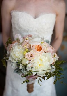 Bridal bouquet of white and pink peonies.