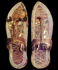 A pair of Tutankhamun's sandals with pictures of his captured enemies on the sole. A Syrian and a Nubian or sub-Saharan native.