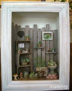 ____••Maisons. Made mine from a wooden orange crate.
