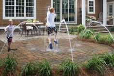 Turn the back patio into a splash pad!  Should be easy-- run some pvc pipe around the perimeter and poke holes in it at strategic intervals.