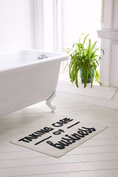 Taking Care Of Business Bath Mat $19.99