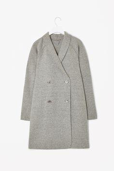 Raw-edged wool coat