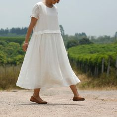 WHITE women loose fitting linen dress,gown,very graceful,ship via HK post.   http://www.aliexpress.com/store/product/SIMPLE-LIVING-white-women-Maxi-loose-fitting-long-dress100-Linen-dress-gown-original-design-elegance-graceful/1247503_1886773599.html