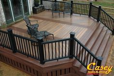 500 square foot Fiberon composite IPE deck with Fiberon Rosewood inlays, picture frame border, stairs, risers, and custom designed trim / skirting. The stair case is 16 feet wide and has low voltage L.E.D. i-lighting. The railings are Timber tech black Radiance Rail. The decking was installed with hidden fasteners.
