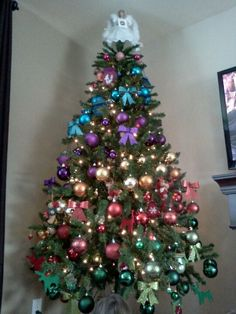 New 2018 Holiday Trend! Check out the Rainbow Christmas Tree trend! Rainbow Christmas Tree, Christmas Tree Design, Beautiful Christmas Trees, Christmas Tree Themes, Holiday Themes, Christmas Colors, All Things Christmas, Christmas Holidays, Christmas Ideas