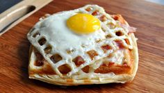 Egg cooked on a waffle iron! I may never use the skillet for eggs again! LOVE LOVE LOVE and so much fun for the kiddos!
