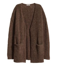 Dark brown melange. Cardigan in a soft mohair blend with dropped shoulders, long sleeves, front pockets, and no buttons.