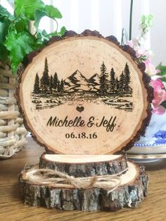 Sweet rustic wedding cake topper Made from wood slices Laser engraved with your names and date Twine bow Size: Approx. 4 x 5 When purchasing, leave your info in the note to seller on the check out page. I try to keep my turn around time to one week