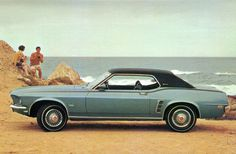 1969 Ford Mustang Grande' Coupe. This was my third car and third Mustang. Her name was Mindy.
