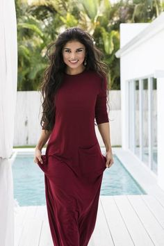 Slim fitting lightweight Bordeaux maxi dress with a rounded neck and 3/4 sleeves. A-line silhouette features a jumbo crooked pocket. Take this dress from beach