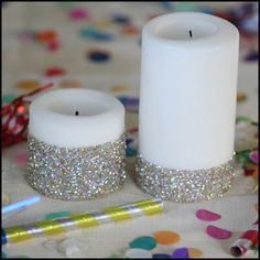 Glitter Candles- Step 1: Place masking tape in a straight line wherever you'd like on the pillar candle. Step 2: Smear glue everywhere below the tape. Step 3: Sprinkle any color glitter you'd like onto the glue. Step 4: Shake off any accsess glitter and let dry. TIP: To avoid glitter falling everywhere, spray the glitter with hairspray. Enjoy!