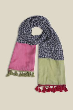 Perfect for adding print and colour to simple everyday styles. Wear our beautiful Artisan Dotty Scarf over plain t shirts and knits for an instant update to your outfit. Made from 100% viscose, this scarf is lovely and soft and finished off pink and green tassels.   100% viscose  Wash on delicate cycle