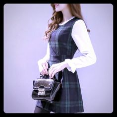 Navy plaid mini dress with built in white blouse. Adorable schoolgirl dress in a classic black watch plaid. Built in white blouse with ruffle detailing at neck & sleeves. 32 inches from shoulder to hem with a 36 inch bust. Fairyland Dresses Mini