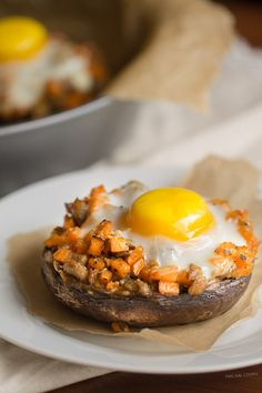 Sausage + Sweet Potato Stuffed Portobello: Chicken Sausage and diced sweet potatoes stuffed in portobellos and topped with an egg then baked!
