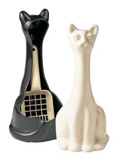 Cat sculpture? No, it's hiding the kitty litter scoop in plain sight. Perfect gift for cat lovers...get yours now.