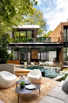 This modern outdoor space has been landscaped with a variety of different areas, including a swimming pool and deck, a lounge area with outdoor kitchen and fireplace, and a dining area. Outdoor Living, Outdoor Decor, Backyard, Deck Patio, The Outsiders, Bring It On, Doors, Mansions, House Styles