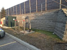 Buliding retaining walls like this allowed for out client to expand their parking lot by pushing the transformer into the hill. http://www.facebook.com/LakeridgeContracting