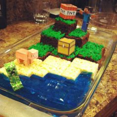 Minecraft cake made with minecraft printables found on their website and held down with toothpicks to make sturdy and candles were stuck into the TNT box