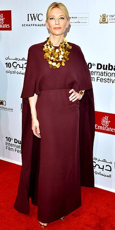 CATE BLANCHETT It's not her first cape and we doubt it'll be her last. Cate selects an eggplant-hued Valentino gown with loose sleeves, plus a dramatic gold statement necklace, for the Opening Night Gala at the Dubai Film Festival.