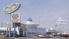 Retro-futuristic architecture is heavily inspired by the space and atomic ages of the mid-20th century. Otherwise known as Googie architecture, buildings in this style were created with a durable steel construction, upswept roofs, domes and the use of decorative neon lighting. (CynicalC, 2010)