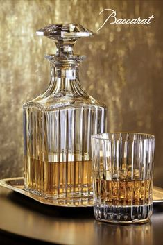 The Harmonie square whiskey decanter in clear crystal stands like a crystal column, at once understated and elegant. The classic shape with delicate engraved lines creates a play on texture that produces a stunning effect. Whiskey Gifts, Cigars And Whiskey, Whiskey Decanter, Whiskey Glasses, Crystal Stemware, Clear Crystal, Whiskey Room, Whisky Bar, Olive Oil Bottles