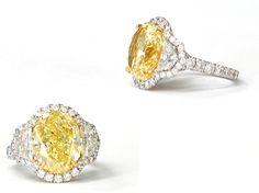 Custom 9.08 carat Oval Natural Fancy Yellow Diamond and White Diamond Ring