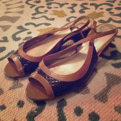 Brown Wedge Sandals Adorable brown wedge sandals perfect for spring. Small kitten wedge, peep toe. Elastic on clasp is slightly worn. Etienne Aigner Shoes Sandals