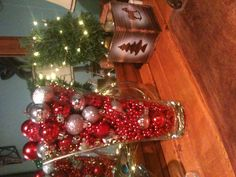 Glass vase, string of beads, and a few small ornaments = Christmas decor galore!