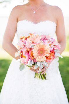 A perfectly sweet summertime bouquet: http://www.stylemepretty.com/maryland-weddings/2014/08/28/north-beach-maryland-wedding-full-of-happy-color/   Photography: Robyn Van Dyke - http://www.robynvandykephotography.com/