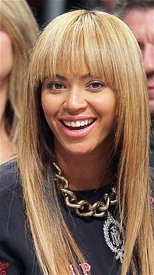 Photo: Jim McIsaac/Getty Images  Cute Beyonce. She looks great with the long blond hair. The cute bangs and very straight smooth cut looks effortless but no doubt it is not. A lot of work goes into making this girl look good.