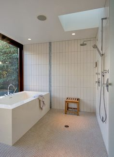 this bath area with drainage and waterproof surfaces that mean no glass enclosure is needed reminds me of a japanese bathroom