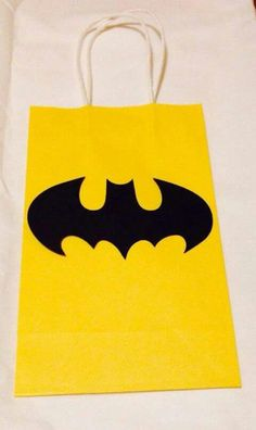 you could buy dif color bags and make simple superhero symbols and glue on bags. then put kids names on each bag under symbol? Batman Birthday, Superhero Birthday Party, Third Birthday, 4th Birthday Parties, Boy Birthday, Birthday Ideas, Batgirl Party, Lego Batman Party, Superhero Symbols