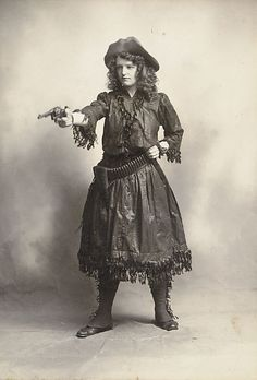 "Cabinet Photo of unidentified young Wild West Woman wearing silk ""buckskins"" and pointing a Colt."