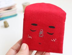 travel pouch, coin purse, hand embroidered and painted sleeping face in red