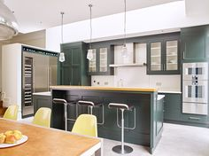 Trainspotters.co.uk - Communist prismatic pendants in this dark green kitchen designed by http://www.woodstockfurniture.co.uk http://www.trainspotters.co.uk/products/lighting/prismatic-blender-pendant