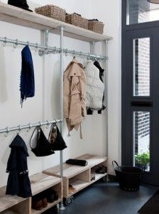 Closet with pipes and wood - solution for a front entrance with no closet
