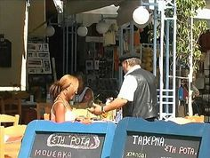 Candid scene of popular small 'taverna' (restaurant) on the island of Poros,Greece. This Saronic island is located about 1 hour from the port of Athens (Piraeus) by high speed boat. It is in the vicinity of Hydra(island).  1great-trip.com