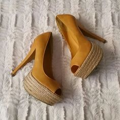Heels Mustard color heels with straw material  platform. Only worn in store at purchase. has red dot on shoe barely noticeable and has indent on on top shoe from trying on. Great for fall! Dollhouse Shoes Heels