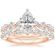 Classic yet captivating, this set features floating shared prong diamonds creating a light and lustrous look total carat weight). Our unique engagement rings are hand-crafted to order using ec Marquise Cut Diamond Ring, Diamond Rings, Bridal Sets, Eternity Ring, Diamond Shapes, Chokers, Rose Gold, Engagement Rings, Gemstones