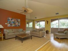 - SOLD - Yellow and orange rec room - wood floors - Stonegate in Naples, FL