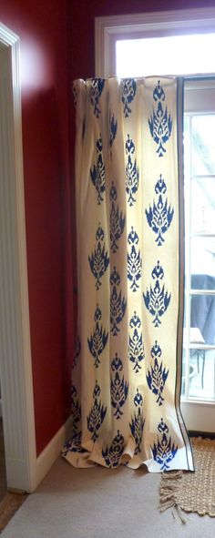 Stenciled drop cloth curtain. Tip for using Textile Medium mixed with cheap acrylic craft paint instead if more expensive fabric paint.