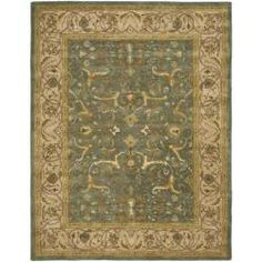 An intricate Oriental design and dense, thick pile highlight this handmade rug. This floor rug has a blue background and a beige border and displays stunning panel colors of gold, green, red and ivory./Handmade-Heritage-Kashen-Blue-Beige-Wool-Rug-83-x-11