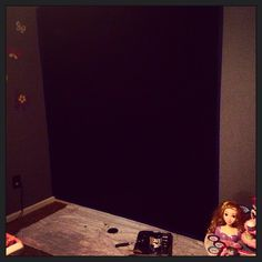 Just painted the girls a chalkboard wall in their playroom!!!! Super easy!!