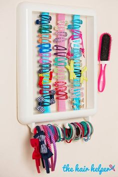 The Hair Helper How clever and cool is this hair accessory organiser frame! Able to be personalised with ribbon colours and letter stickers. Holds hair ties, hair brush and clips! Perfect gift for little girls