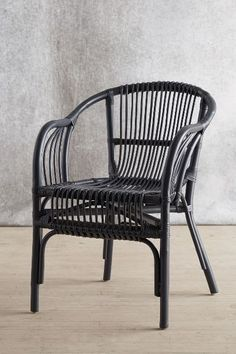 Pari Rattan Chair - anthropologie.com online only $99 dark gray 31''H, 22''W, 27.5''D